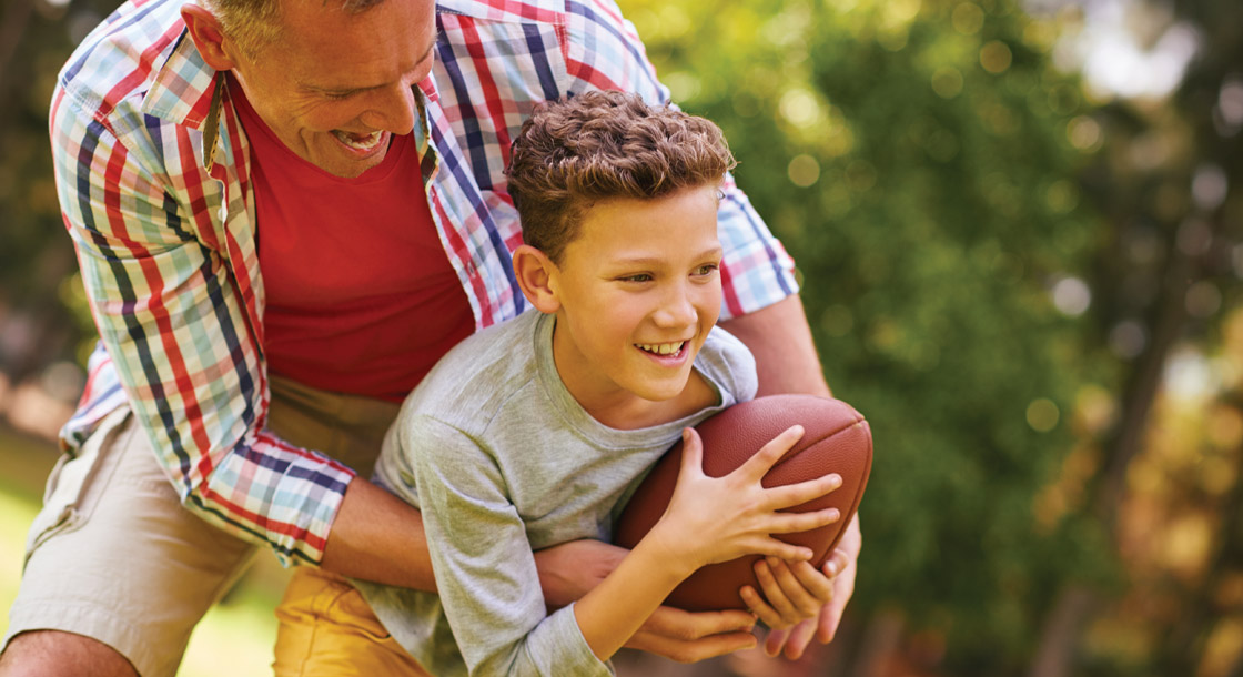 dad-and-son-playing-football