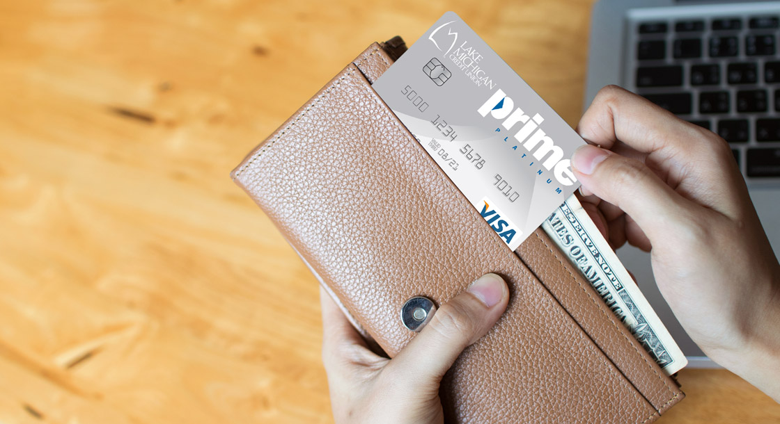 woman pulling prime platinum card out of her wallet
